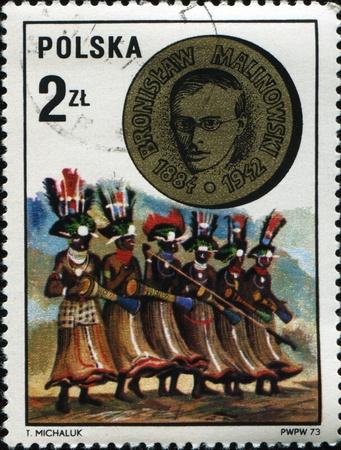 anthropologist: POLAND - CIRCA 1973: A stamp printed in Poland shows Bronisław Kasper Malinowski (a Polish- British anthropologist) and New Guinea dancers, circa 1973 Stock Photo
