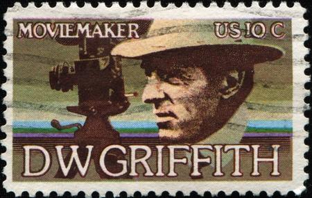 pioneering: UNITED STATES OF AMERICA - CIRCA 1975: A stamp printed in the United States of America shows David Llewelyn Wark Griffith was a premier pioneering American film director,  circa 1975