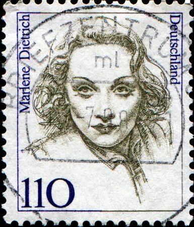 FEDERAL REPUBLIC OF GERMANY - CIRCA 1997:  A stamp printed in the Federal Republic of Germany shows Marlene Dietrich, German-born American actress and singer, circa  1997