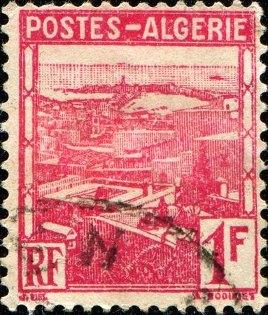 ALGERIA - CIRCA 1941: A stamp printed in Algeria shows view of Algiers, circa 1941 Stock Photo - 11262455