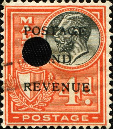 MALTA- CIRCA 1930: A stamp printed in Malta shows image of King George V, circa 1930