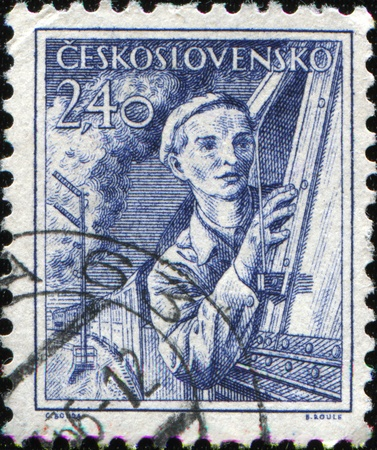 CZECHOSLOVAKIA - CIRCA 1954: A stamp printed in Czechoslovakia shows woman engine driver, circa 1954  photo