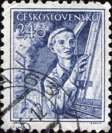 CZECHOSLOVAKIA - CIRCA 1954: A stamp printed in Czechoslovakia shows woman engine driver, circa 1954  photo