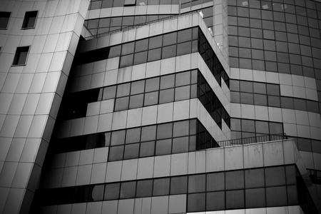 glass building: black and white photo of modern building