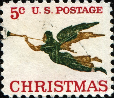 UNITED STATES OF AMERICA - CIRCA 1965: A greeting Christmas stamp printed in the USA shows Archangel Gabriel (after painting by L. Chabot) , circa 1965 Stock Photo - 11262435