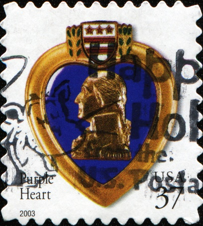 awarded: USA - CIRCA 2003: A stamp dedicated to The Purple Heart is a United States military decoration awarded in the name of the President to those who have been wounded or killed, circa 2003