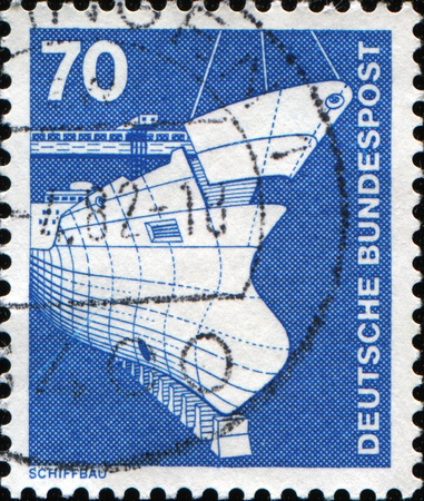 bundespost: GERMANY-CIRCA 1975: A post stamp printed in Germany shows a ship, devoted Industry and technic, circa 1975  Stock Photo