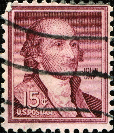 USA - CIRCA 1930: A stamp printed in USA shows American politician, statesman, revolutionary, diplomat, a Founding Father of the United States, and the first Chief Justice of the United States (1789�95) John Jay, circa 1930.  photo