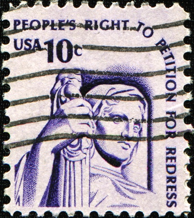 USA - CIRCA 1975: A stamp printed in the USA shows Contemplation of Justice (statue, J. E. Fraser), circa 1975 photo