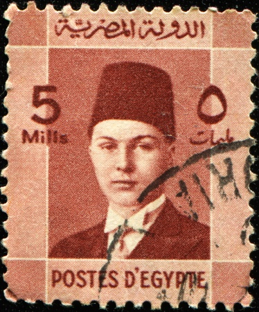 farouk: EGYPT - CIRCA 1937: A stamp printed in Egypt honoring Investiture of King Farouk, circa 1937 Stock Photo
