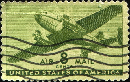 avia: UNITED STATES OF AMERICA - CIRCA 1945: A stamp printed in the USA shows airplane, circa 1945