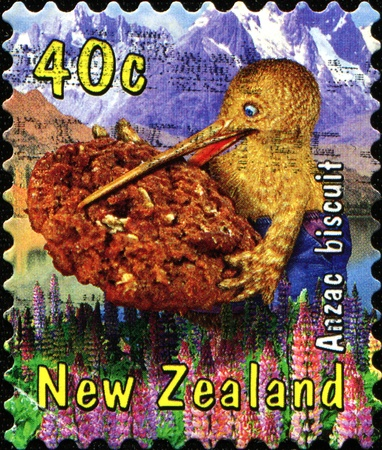 NEW ZEALAND - CIRCA 2000: A stamp printed in New Zealand shows kiwi bird holding in its beak Anzac biscuit, circa 2000 Stock Photo - 11262284