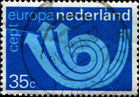 posthorn: NETHERLANDS - CIRCA 1972: A stamp printed in Netherlands shows posthorn, circa 1972