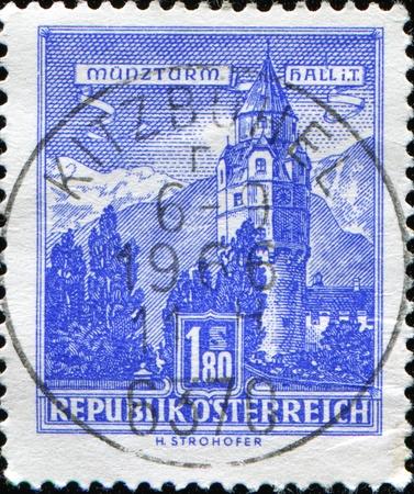 tyrol: AUSTRIA - CIRCA 1957: A stamp printed in Austria shows the Munzturm Hall in the Tyrol region of Austria, series, circa 1957