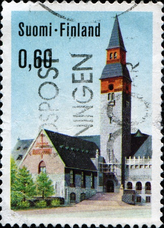 FINLAND - CIRCA 197: A stamp printed in Finland  shows National Museum of Finland (Suomen kansallismuseo), Helsinki, circa 1973 photo