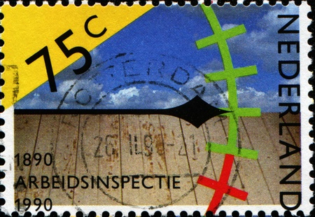 centenary: NETHERLANDS - CIRCA 1990: A stamp printed in Netherlands honoring Centenary of Labour Inspectorate, shows Pointer on Graduated Scale, circa 1990