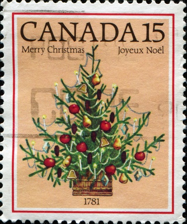 CANADA - CIRCA 1981: A stamp printed in Canada shows Christmas, bicentenary of 1st illuminated Christmas tree in Canada, 1781, circa 1981  photo