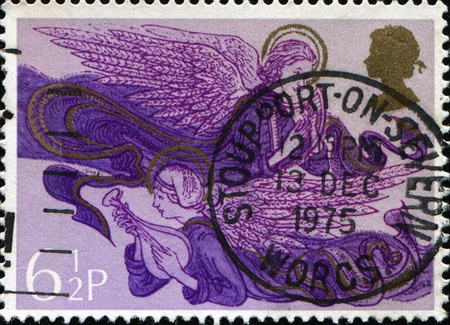 UNITED KINGDOM- CIRCA 1975: A stamp printed in United Kingdom shows Christmas Angels with Harp and Lute, circa 1975 Stock Photo - 11262237