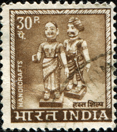 indian postal stamp: INDIA - CIRCA 1965: A stamp printed in India shows Indian dolls, circa 1965 Stock Photo