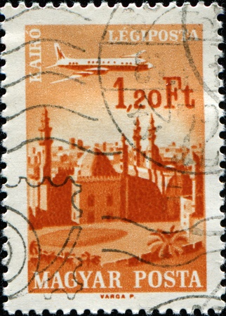 canceled: HUNGARY - CIRCA 1966: A stamp printed in Hungary shows flying plane over Cairo, series, circa 1966