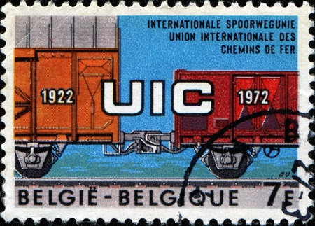 BELGIUM - CIRCA 1972: Postage stamp published in Belgium commemorating 50th Anniversary of Int Railways Union, shows UIC on Coupled Wagons, circa 1969 Stock Photo - 11262247
