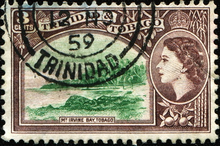 TRINIDAD AND TOBAGO - CIRCA 1953: A stamp printed in Trinidad and Tobago shows Mount Irvine Bay, Tobago Designs as 1938 and 1940 issues but with portrait of Queen Elizabeth in place of King George VI Stock Photo - 11262187