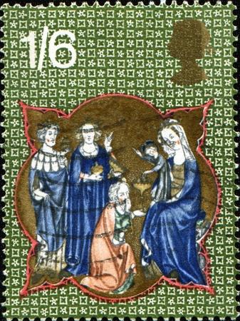 UNITED KINGDOM - CIRCA 1970: A British Used Christmas Postage Stamp shows adoration of magy, circa 1970  photo