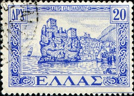 GREECE - CIRCA 1947: A stamp printed in Greece shows Castelrosso Fortress, circa 1947 photo