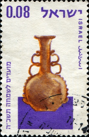ISRAEL - CIRCA 1964: A stamp printed in Israel shows 3rd Century glass vessels in Haaretz Museum, Tel Aviv, series, circa 1964 photo