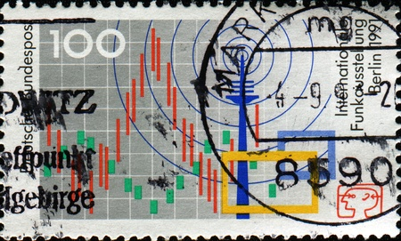 FEDERAL REPUBLIC OF GERMANY - CIRCA 1991: A stamp printed in the Federal Republic of Germany honoring  International Radio Exhibition, Berlin, shows Radio Waves and Mast, circa 1991 photo