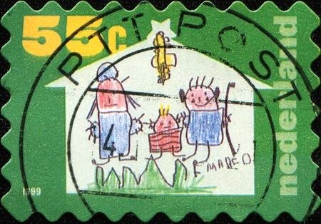NETHERLANDS - CIRCA 1999: A Christmas greeting stamp printed in the Netherlands shows Winning entries in design competition, Baby with angel wings (Rosmarijn Schmink), series, circa 1999 photo