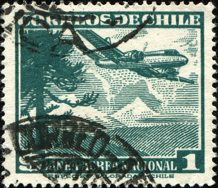 CHILE - CIRCA 1950: A stamp printed in Chile shows airplane ower Araucanian pine tree, circa 1950 photo