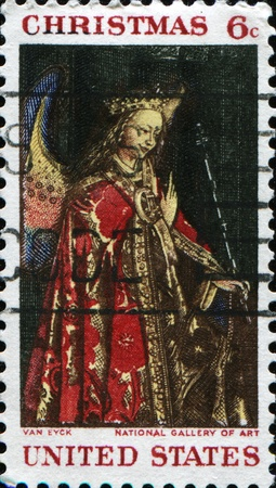 angel gabriel: UNITED STATES - CIRCA 1968: A Christmass greeting stamp printed by United States of America  shows Angel Gabriel from The Annunciation, Jan Van Eyck, circa 1968