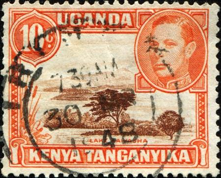 lake naivasha: KENYA, UGANDA AND TANGANYIKA - CIRCA 1938: A stamp printed in Kenya, Uganda and Tanganyika shows Lake Naivasha, circa 1938