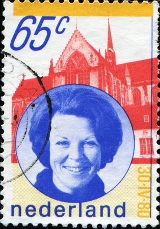 beatrix: NETHERLANDS - CIRCA 1980: A stamp printed in Netherlands shows Queen Beatrix against Palace, circa 1980  Stock Photo