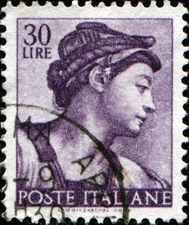 ITALY - CIRCA 1961: A stamp printed in Italy shows Erythraean Sibyl, fragment of painted ceiling of the Sistine Chapel, Vatican, fresco by Michelangelo, circa 1961  photo