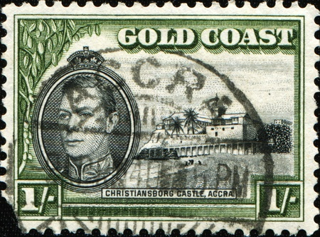 GOLD COAST - CIRCA 1938: A stamp printed in Gold Coas shows King George VI and Christiansborg Castle, Accra, circa 1938 photo