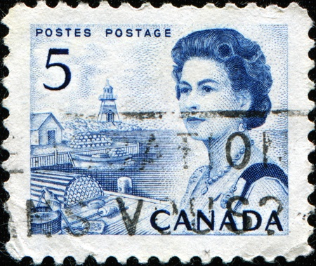 CANADA - CIRCA 1967: A stamp printed in Canada shows Queen Elizabeth II against background of Harbour scene, circa 1967 Stock Photo - 11370178