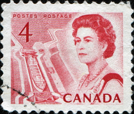 CANADA - CIRCA 1967: A stamp printed in Canada shows Queen Elizabeth II against background of locks on the river Huron, circa 1967  Stock Photo - 11370181