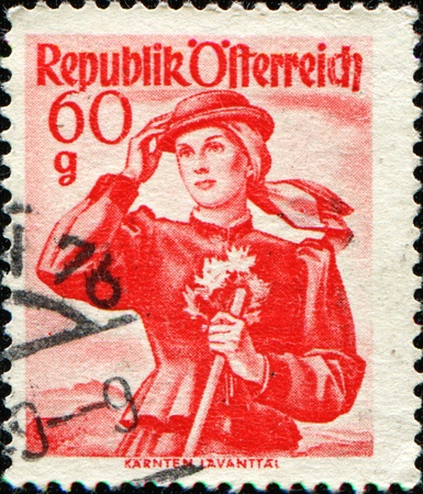 trachten: AUSTRIA - CIRCA 1948: A stamp printed in Austria shows a woman in national dress, Carinthia, Lavant Valley, circa 1948