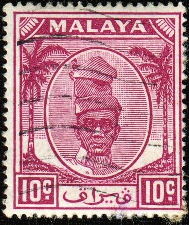 shah: PERAK - CIRCA 1950: A stamp printed in Perak (a state in the current Federation of Malaysia) shows  Sultan Yussuf Izzuddin Shah of Perak, circa 1950 Stock Photo
