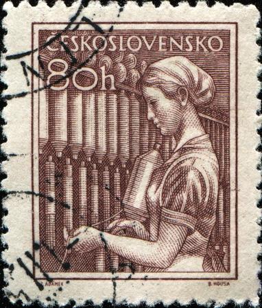 CZECHOSLOVAKIA - CIRCA 1954: A stamp printed in Czechoslovakia shows Mill girl, circa 1954 photo