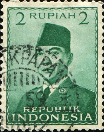 sukarno: INDONESIA - CIRCA 1951: A stamp printed in the Indonesia shows the first president of Indonesia Sukarno, circa 1951