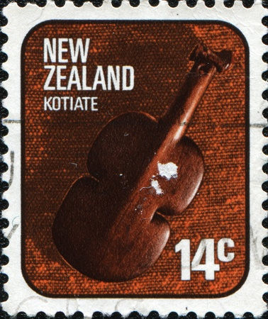 NEW ZEALAND - CIRCA 1976: A stamp printed in New Zealand shows Kotiate, traditional type of handguns people Maori, circa 1976  photo