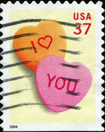 UNITED STATES OF AMERICA - CIRCA 2004: An I love you stamp printed in the USA shows two hearts, circa 2004 photo