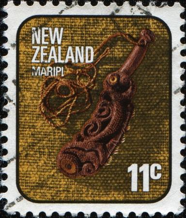 NEW ZEALAND - CIRCA 1976: A stamp printed in New Zealand shows maripi, traditional type of handguns people Maori, circa 1976  photo