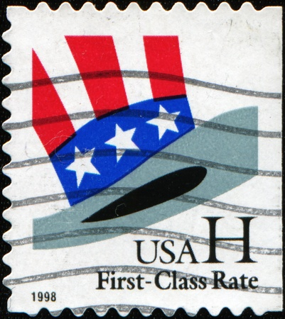cancelled stamp: UNITED STATES OF AMERICA - CIRCA 1998: A stamp printed in the USA shows Uncle Sams Hat, circa 1998
