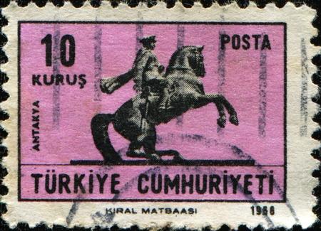 TURKEY - CIRCA 1968: A stamp shows  Equestrian statues of  Mustafa Kemal Ataturk at Antakya, circa 1968 photo