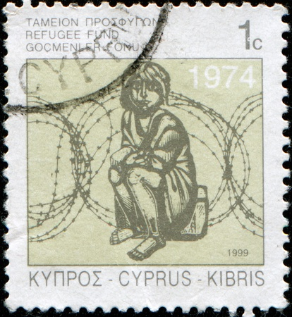 CYPRUS - CIRCA 1999: A stamp printed in Cyprus honoring Commission for Refugees, shows girl sitting on a suitcase against the barbed wire, circa 1974 photo