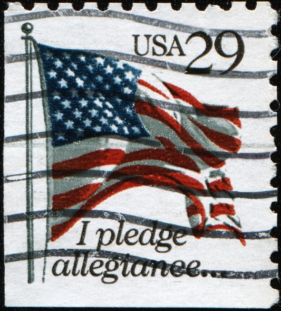 allegiance: USA - CIRCA 1993: A stamp printed by USA shows the USA Flag and words I pledge allegiance, circa 1993